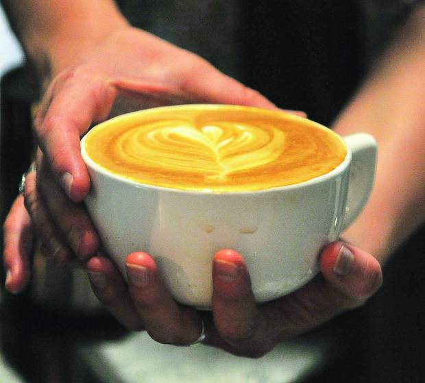 A warm late is made by Natalee Heilaman Thursday at Brew Bakers in Grass Valley.