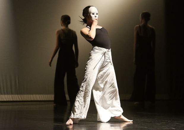 A masked dancer performs in Nevada Wadman's choreographed piece