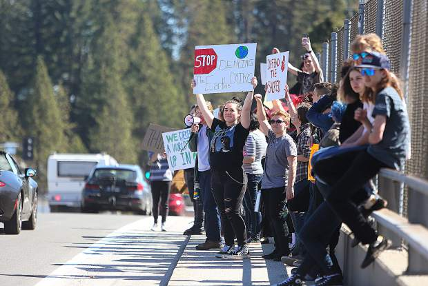 Students from Bitney Preps environmental science class and elective classes took to the Brunswick overpass, along with their instructors, to participate in the global student walkout for climate change Friday. Students were off campus for about 1/2 hour before returning.