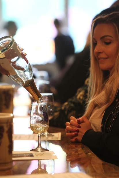 A glass of wine is poured from inside Sierra Starr during Saturday's Foothills Celebration.