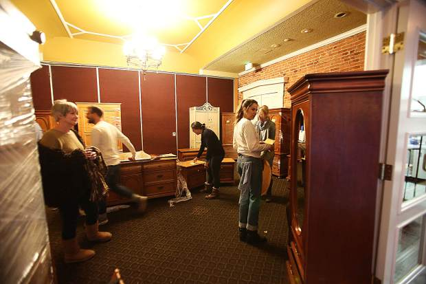 Estate sale hunters and enthusiasts of the historic Holbrooke Hotel peruse through the many items for sale during Saturday's sale.