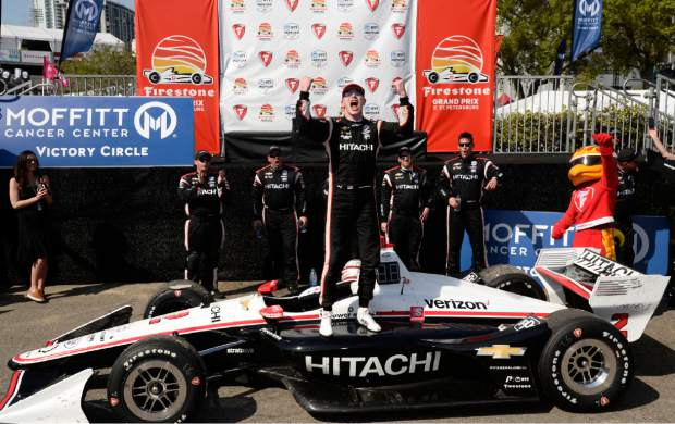 Team Penske driver Josef Newgarden (2), of United States, celebrates after winning the IndyCar Firestone Grand Prix of St. Petersburg (Fla.) auto race Sunday, March 10, 2019, in St Petersburg, Fla. (AP Photo/Jason Behnken)