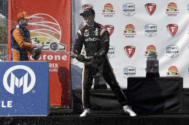 Team Penske driver Josef Newgarden, of the United States, celebrates after winning the IndyCar Firestone Grand Prix of St. Petersburg (Fla.) auto race Sunday, March 10, 2019, in St Petersburg, Fla. (AP Photo/Jason Behnken)