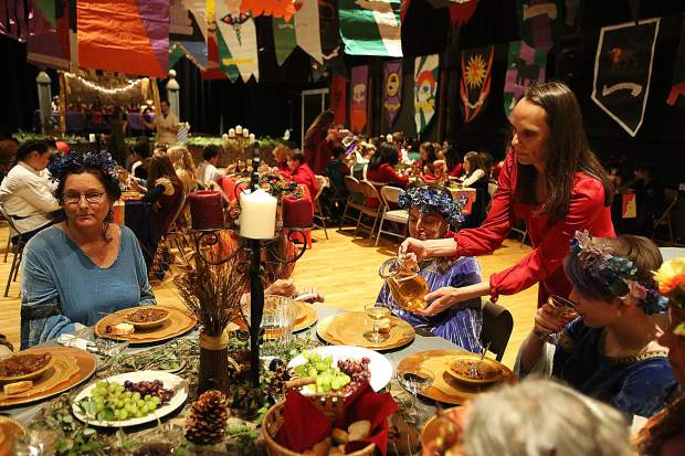 Food, drink, and desserts are served during the Seven Hills Middle School Medieval Feast.