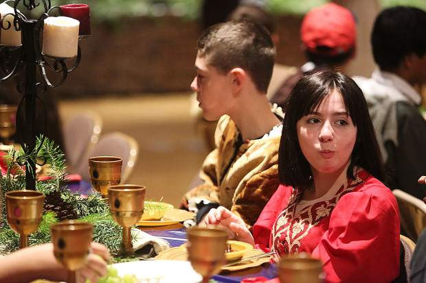 Students enjoy the entertainment and food during Wednesday's Medieval Feast.
