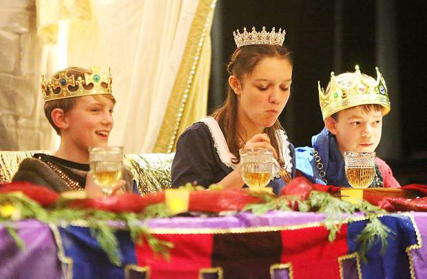 Seven Hills Middle School Medieval Feast royalty enjoy their meal while watching over the days' entertainment and festivities Wednesday at the Miners Foundry in Nevada City.