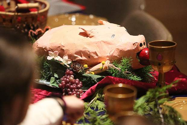 A paper cache pig sits as a table centerpiece during Wednesdays' Medieval Feast.