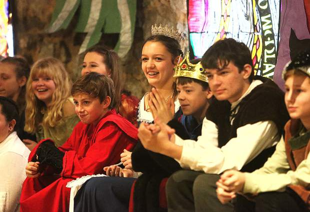Fellow middle schoolers applaud their classmates as they compete in the jousting competition.