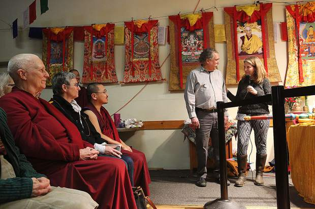 Sierra Friends of Tibet founder Joseph Guida is presented with a trip to the Gaden Shartse monastery in India so he can see for himself where the Tibetan monks that come to Grass Valley each year travel from.