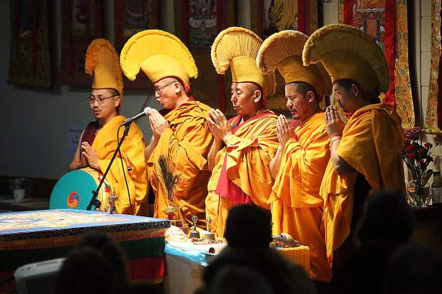 The group of five Tibetan monks from the Gaden Shartse Monastery prepare to begin their dissolution ceremony where they will disseminate the sand mandala to members of the community in attendance of the closing ceremony Saturday.