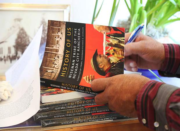 Nisenan Tribal Chairperson Richard B. Johnson signs his book for attendees of his two hour talk given at the North Columbia Schoolhouse Saturday.