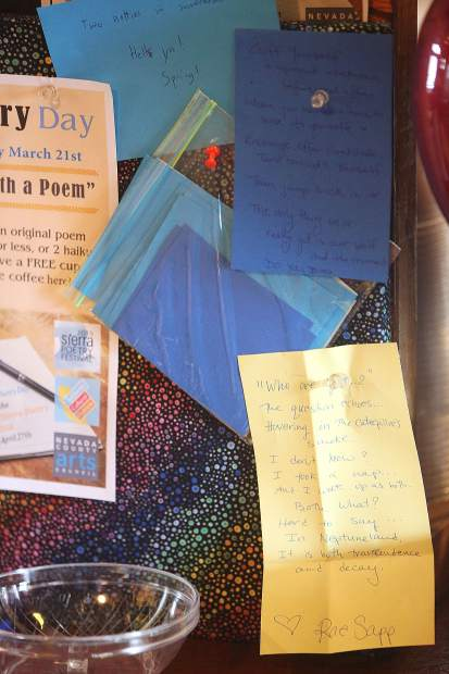 Poems adorn the bulletin board at Foxhound in Nevada City Thursday morning during Pay with a Poem day.