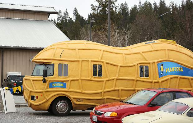 The peanut shaped body of the Nut Mobile sits on a vehicle frame similar to a UPS truck.