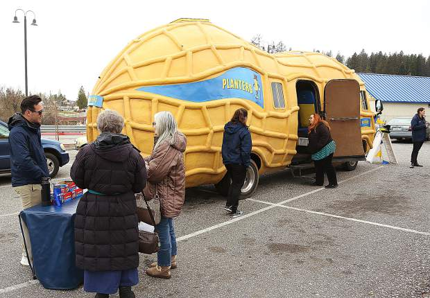 Planters Peanuts representatives pass out peanuts and promotional material while giving tours of the Nut Mobile Friday in the Dollar General parking lot in Grass Valley.