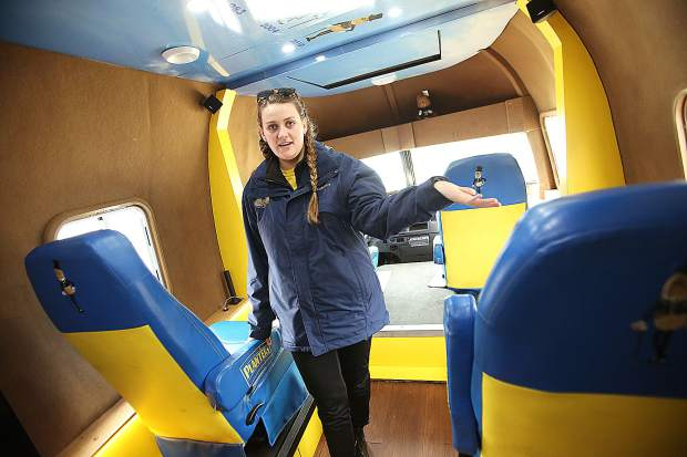 Grass Valley's Kelly Beach shows off the interior of the Nut Mobile which she helps to pilot along with two other drivers.