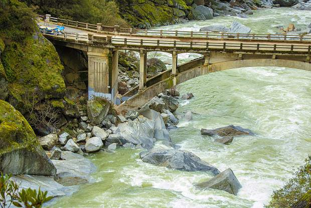 Outing to see the condition of the Yuba/49 bridge this morning: Parking lot is still closed & porta-potties are squished flat - water is definitely flowing fast and turbulent. Lots of new little water falls are popping up feeding into the river. Ferns and moss on trees are gorgeously vibrant greens.
