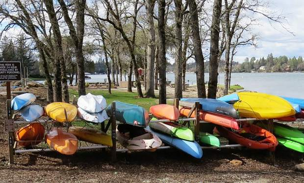 Many kayaks shown at Lake of the Pines and waiting for nicer weather when their owner will take one out.