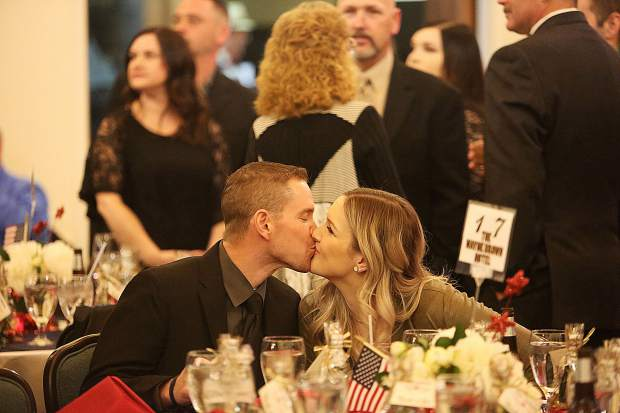 Grass Valley Police Department officer Dale Norvell and his wife Rachel share a kiss during the event.