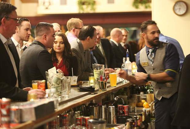 Area police officers firefighters and lawyers share drinks at the bar prior to the evening's program Saturday at the Alta Sierra Country Club.