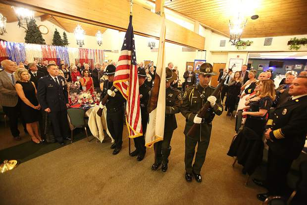 The colors are presented by the Sheriffs Honor Guard at the beginning of the Red Light Ball program.