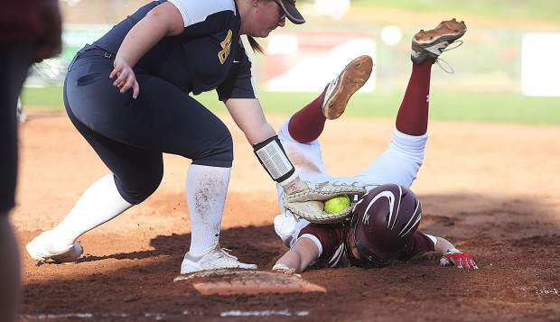 Bear River High School baserunner Emma Gawley is called safe under the age of Nevada Union first base Emree Nau as Gawley rushed to get back to base Thursday at Bear River.