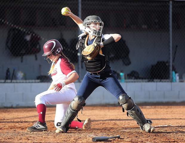 Nevada Union catcher Danielle Schnitzius readies to launch a throw after a Bear River baserunner scores during Thursday's cross county matchup.