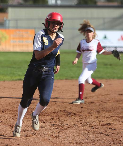 Nevada Union baserunner Vanessa Enriquez rounds second base during a play by the Lady Miners.