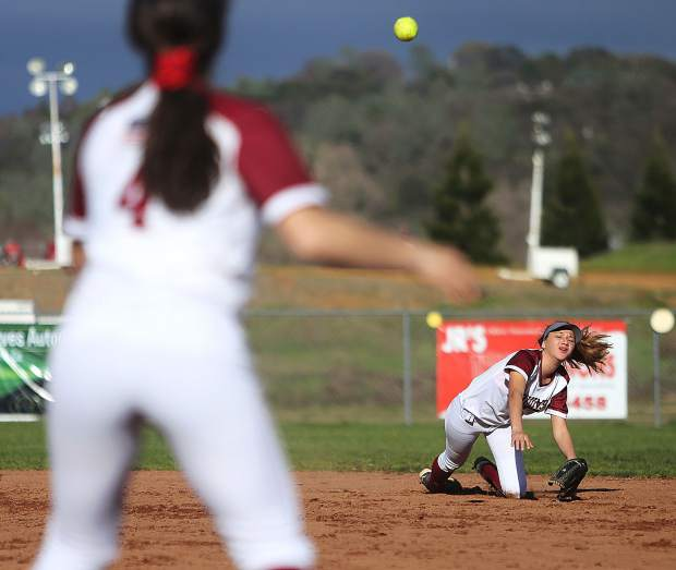 Bear River second base Gabi Corralejo fields an at bat and launches a throw to first base for the out during the Bruins' non-league matchup against the Nevada Union Lady Miners Thursday at home.