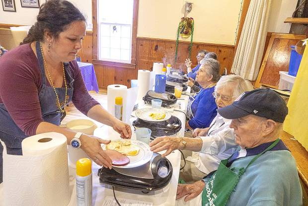 A large lunch crowd turned out for the annual waffle sale Tuesday at Emmanuel Episcopal Church.