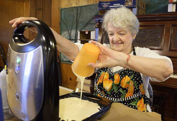 Joan Casper pours batter onto the waffle iron during the 103rd annual Shrove Tuesday Waffle Sale at Emmanuel Episcopal Church in Grass Valley.