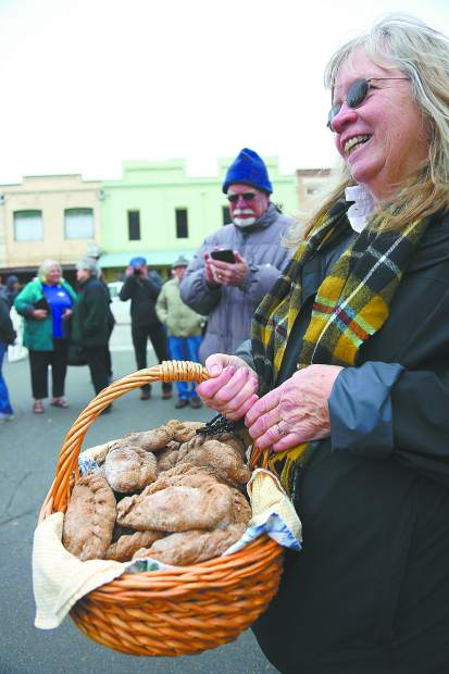 Carol Kinyon holds this year's batch of regulation tossing pastys complete with dog food filling prior to Saturday's St. Pirans Day Pasty Olympics.