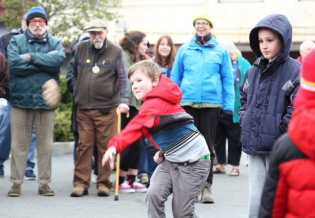 A youngster gives a strong left handed throw towards the target during the pasty toss.