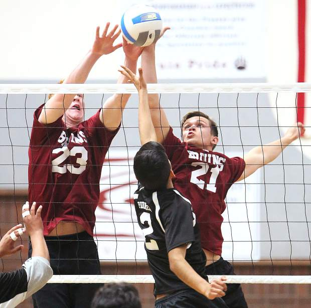 Bear River's Brad Smith (23) and Matt Whiting (21) block a shot to score a point for the Bruins during Tuesday's win in three straight sets over the Pioneer Patriots.