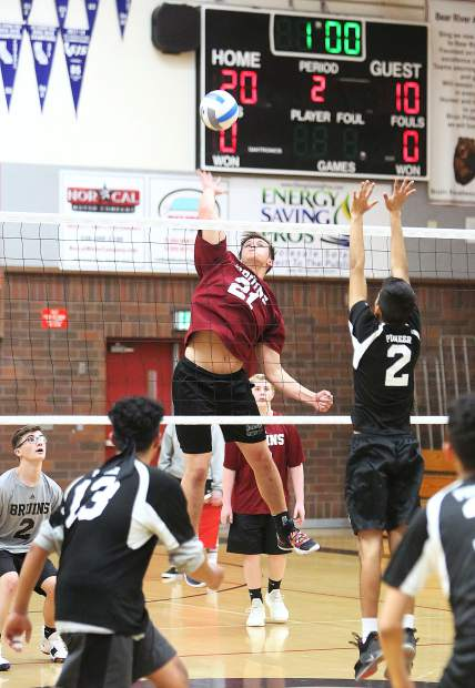 Bear River junior Matt Whiting (21) sends a spike to the Pioneer Patriots during Tuesday's win in three straight sets.