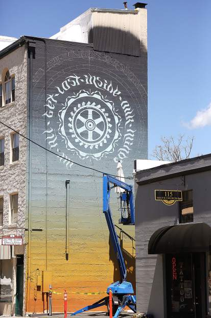 A new mural going up on the Eberhart hotel building in downtown Grass Valley joins the area's other public mural art.