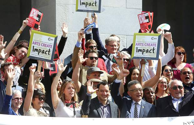 California legislators and arts advocates gather on the steps of the State Capitol building during Tuesday's arts advocacy rally in honor of April being Arts, Culture and Creativity month.