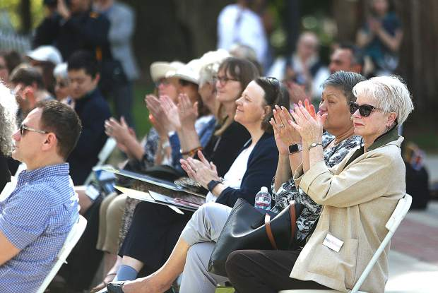 Arts advocacy rally attendees applaud Toby Farwell's performance from in front of the steps of the State Capitol Tuesday.
