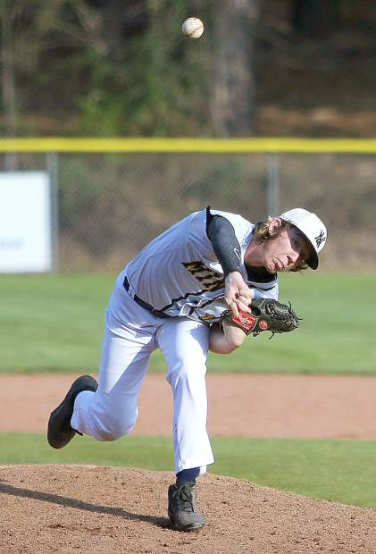 Nevada Union starting pitcher Bennett King fires a pitch during Thursday's 3-2 home win over the Ponderosa Bruins.