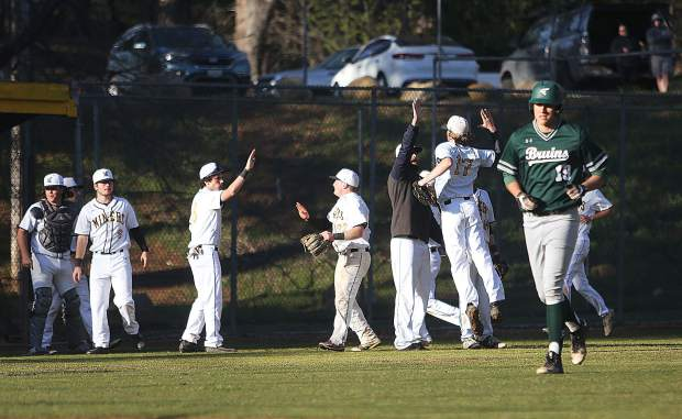 The Miners varsity baseball team celebrates after closing out an inning stranding Ponderosa baserunners in the process during Thursday's win over the Bruins.