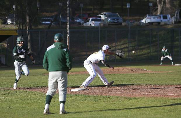 Nevada Union High School first baseman Nick Noll catches the throw to first for the out during the final inning of gameplay during the Miners' 3-2 win over the Ponderosa Bruins Thursday at home.