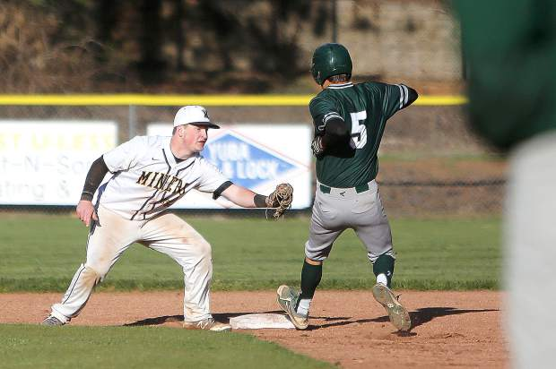 Miners' short stop James Nolen (22) gets the tag on a Ponderosa baserunner trying to steal base.