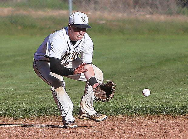 Miners' short stop James Nolen fields a bouncing hit during Thursday's game against the Ponderosa Bruins.