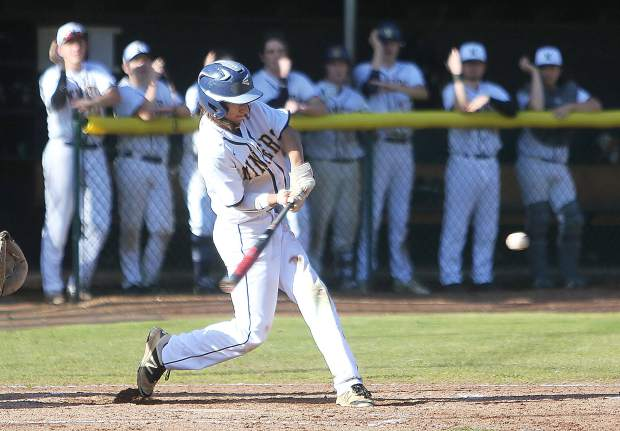 Nevada Union's Zach Erlich gets a base hit during Thursday's win over the Ponderosa Bruins.