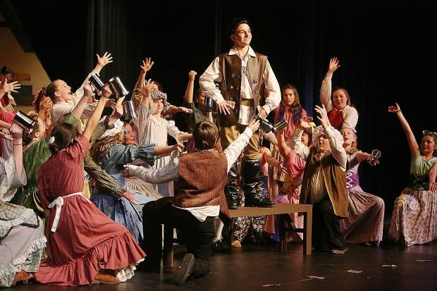 Gaston, played by Max Schug, is adorned by the townsfolk during the production of Beauty and the Beast by the Lyman Gilmore Musical Theater over the weekend at the Don Baggett Theater at Nevada Union High School.