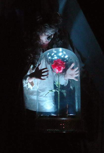 The Beast, played by Brenden Pinney, gazes at the enchanted rose given as a reminder to his curse.