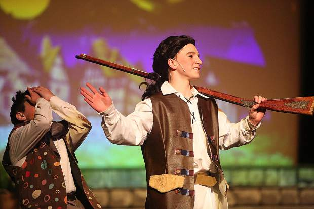 Gaston and Lefou, played by Max Schug and Jack Kehn, captivate the crowd at Don Baggett Theater during their portrayal of Lyman Gilmore Musical Theater's production of Beauty and the Beast.
