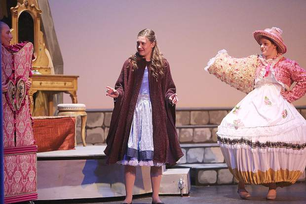 Belle, played by Addison Parmenter is surprised to be greeted by Madame Bouche and Mrs. Potts, played by Kaeli Horn and Gabrielle Goodwin during the weekend's performances of Beauty and the Beast produced by the Lyman Gilmore Musical Theater at Don Baggett Theater. Three showings of the production were held March 22 through the 24.