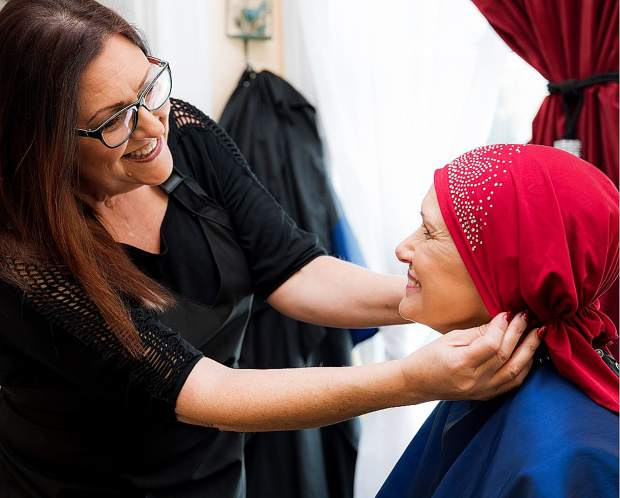 Meleesa Pellerino stylizes a cancer patients hair. Pellerino has been volunteering her time to help cancer patients since 2012.