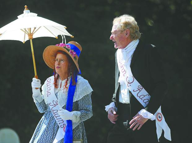 John Quincy Adams and first lady Louisa Adams walk along Broad Street during the Constitution Day Parade.