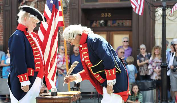 Prior to the Constitution Day Parade is the re-enactment of the signing of the famous document by the members of the Marching Masons portraying the Founding Fathers.